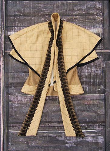 Veste sans manche à cape en laine avec application de dentelle