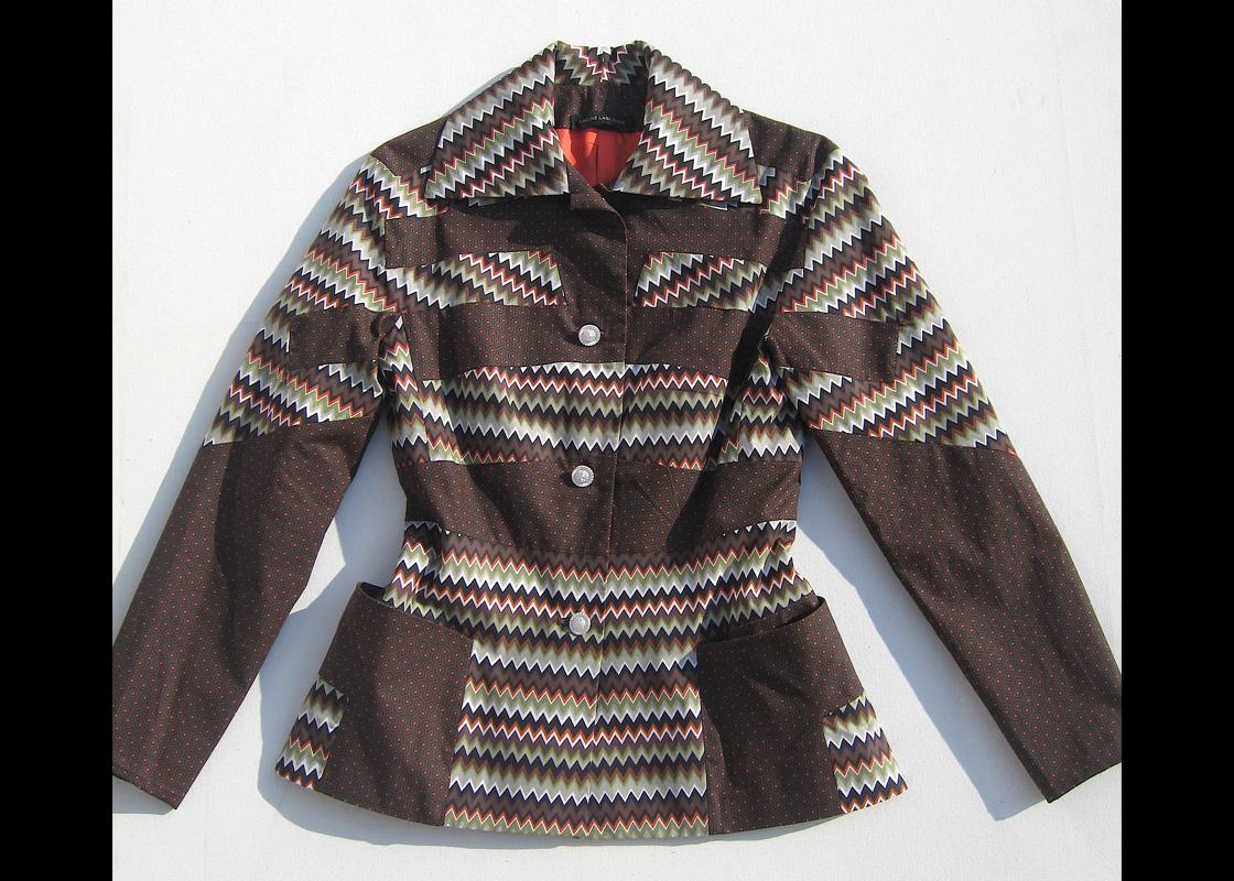 Veste en coton à découpes prenant sur les emmanchures